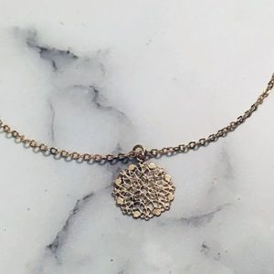 dainty gold-tone floral charm necklace